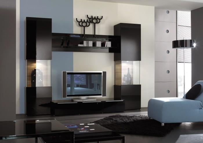Зона для просмотра телевизора в тёмных тонах.