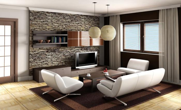 Оригинальный вариант оформления гостиной с декоративной каменной стенкой.