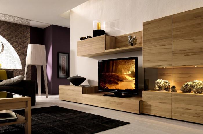 Деревянная модульная стенка для телевизора отлично впишется в любой интерьер.