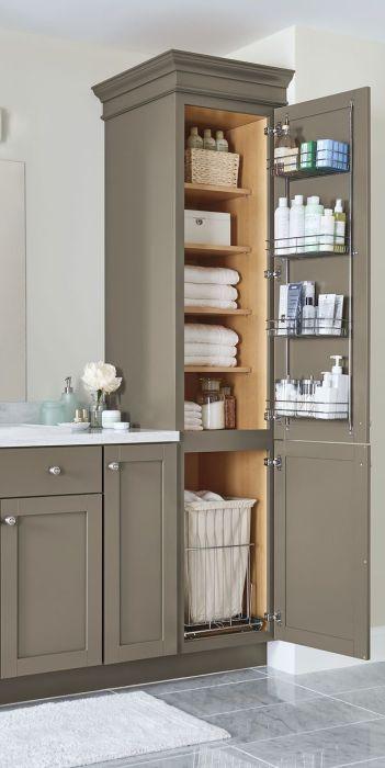 Шкафчик для банных принадлежностей в ванной комнате должен соответствовать общему стилю интерьера.