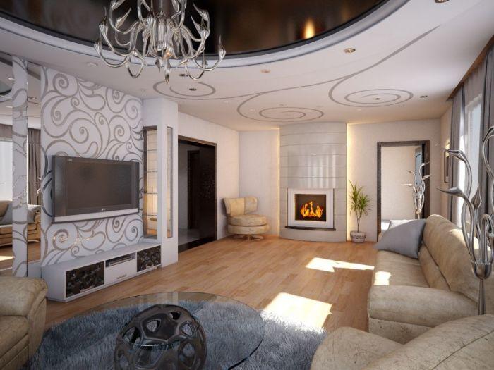 Камин и позолоченные узоры на стенах как дополнение к современному интерьеру гостиной.