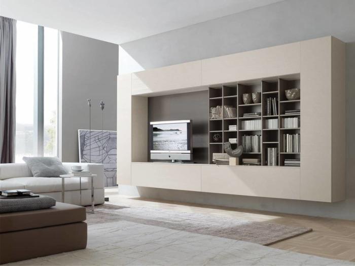 Стильный и оригинальный модульный шкаф - отличное решение, которое визуально увеличит пространство гостиной комнаты.