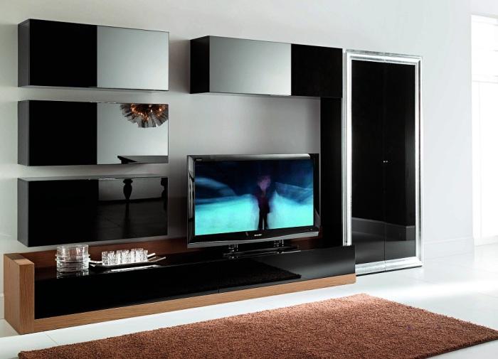 Модульная стенка в зоне для просмотра телевизора в современном стиле позволит за считанные секунды изменить интерьер во всём помещении гостиной.