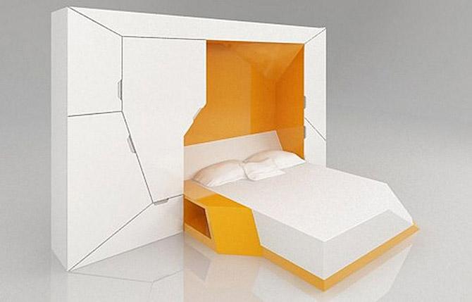 Эта белая стенка состоит из нескольких модулей, которые в зависимости от ситуации могут преображаться в тот или иной предмет мебели.