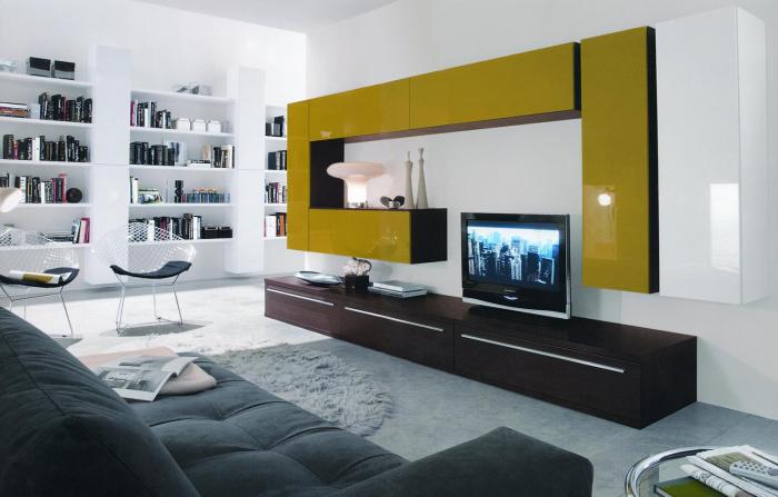 Современная модульная стенка в зоне для просмотра телевизора в минималистском стиле, которая идеально подчёркивает уникальность интерьера гостиной комнаты.