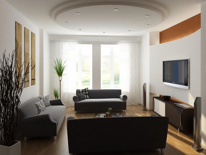 Оригинальная форма потолка и минималистский стиль гостиной создают красоту и уют.