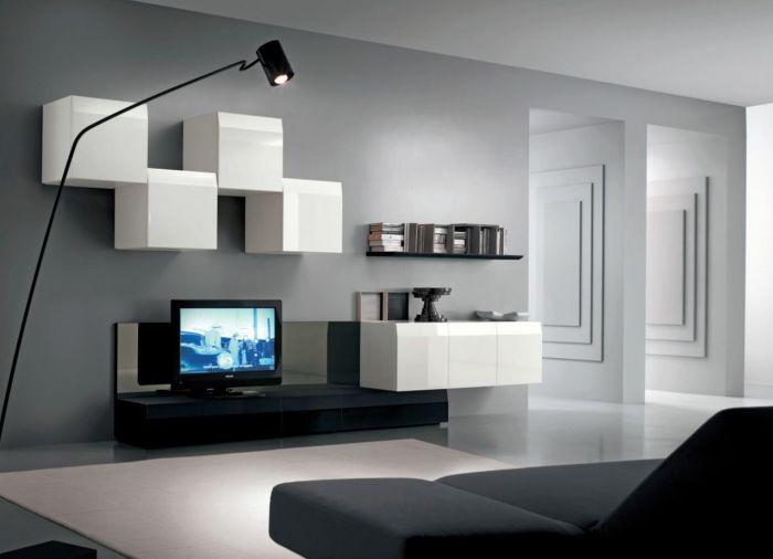 Модульная стенка, в которой сочетаются светлые и тёмные оттенки, впишется в любой интерьер гостиной комнаты.