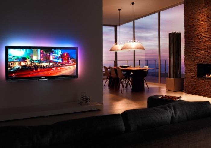 Минимальное оформление зоны для просмотра телевизора обеспечивает максимальную комфортность и эргономичность.