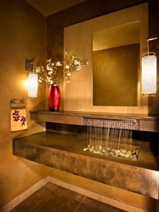 Конструкция раковины-водопада создаст яркий и неповторимый акцент в интерьере ванной.