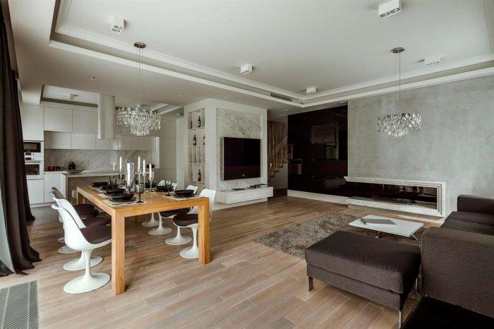 Необычный интерьер апартаментов с компактным и удачным оформлением.