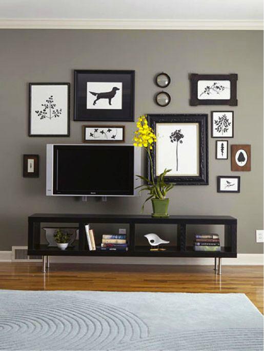 Картины в зоне для просмотра телевизора, которые внесут свою изюминку в интерьер гостиной комнаты.