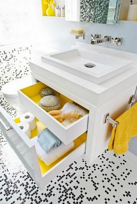 В пространстве под мойкой можно разместить вместительный шкафчик с несколькими выдвижными ящиками.
