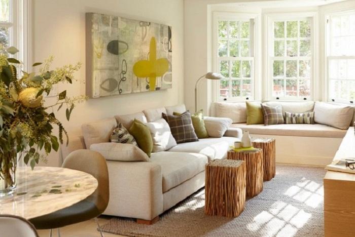 Компактные журнальные столики из деревянных веток, скреплённые вместе, станут настоящей изюминкой любой гостиной комнаты.