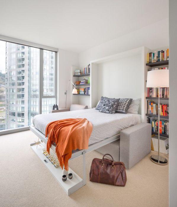 Кровать-трансформер в современном интерьере спальной комнаты, которая позволит значительно сэкономить пространство.