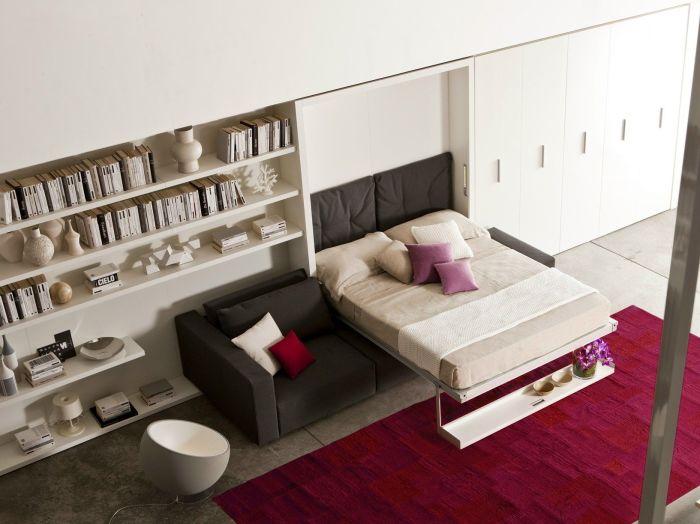 Стеллаж-кровать с небольшим диваном - это идеальное решение для малогабаритной квартиры.