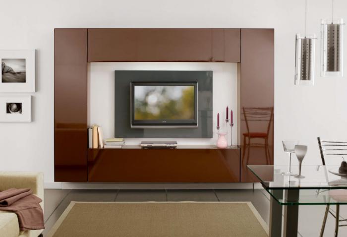 Респектабельная и добротная гостиная с однотонной модульной мебелью.