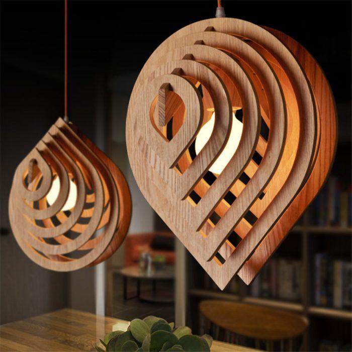 Роскошные деревянные люстры, которые выглядят как настоящие произведения искусства.