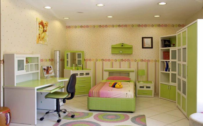 Акцентная мебель зеленного оттенка для современной детской комнаты.