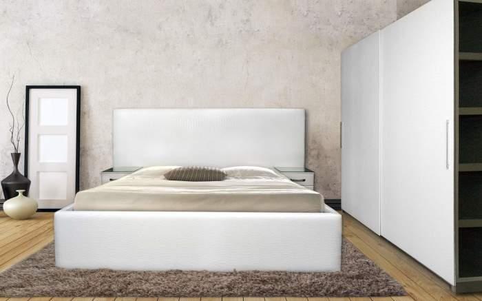 Идеально гармонирующая мебель с интерьером спальни в минималистском стиле.