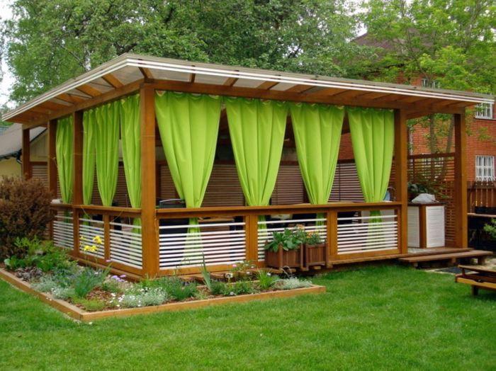 Современный дизайн павильона с яркими салатовыми шторами для дачного участка.