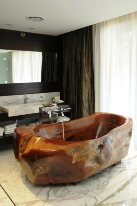 Изысканный дизайн ванны из тёмной породы древесины, которая пользуется огромным спросом у населения благодаря тому, что способна подчеркнуть индивидуальный стиль любой ванной комнаты.