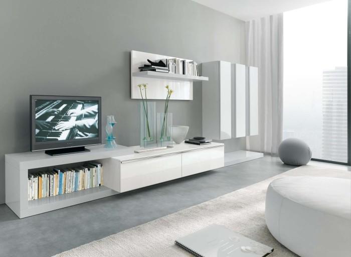 Правильная экономия пространства - залог успешного оформления зоны для просмотра телевизора.