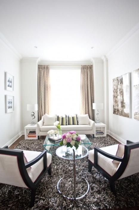 Ковер - неотъемлемая часть современного интерьера гостиной комнаты.