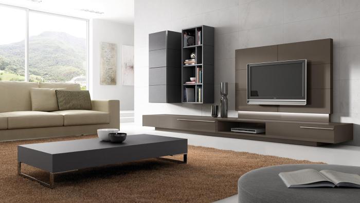 Отличное сочетание классических серых оттенков и современных технологий в зоне для просмотра телевизора.