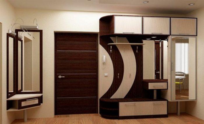 Популярная модель мебельной стенки, которая вместила в себя темные и светлые оттенками древесины.