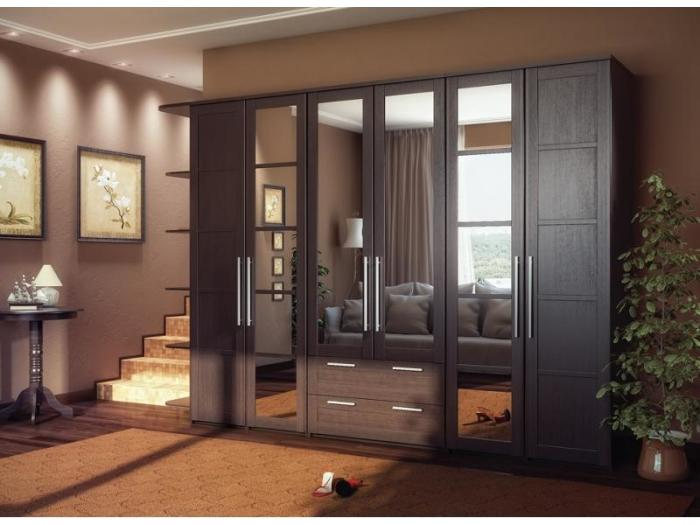 Вместительный шкаф из серии модульной мебели для гостиной комнаты.