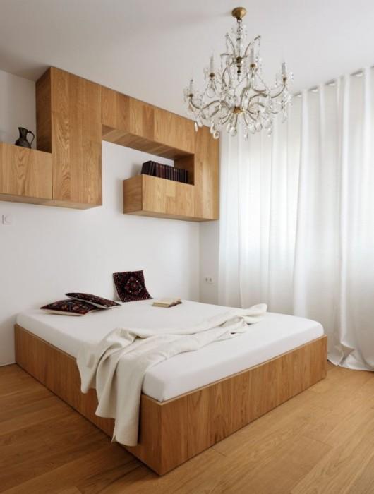 Закрытая настенная модульная мебель идеально подойдет для современной спальной комнаты.