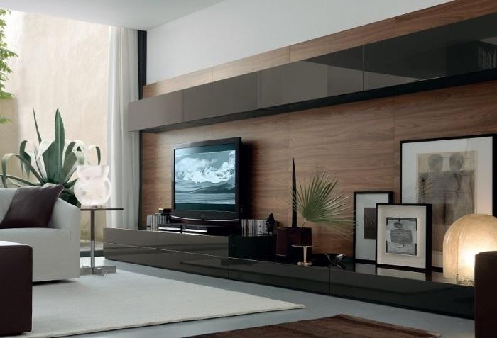 Модульная мебель темного цвета под телевизор для гостиной комнаты.