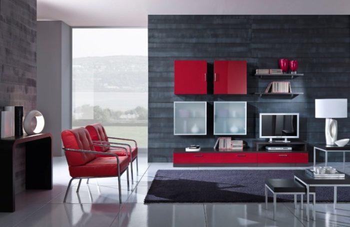 Дизайн гостиной комнаты с красными акцентами.