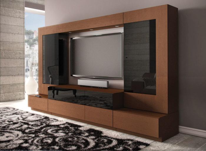 Деревянная модульная стенка для домашнего кинотеатра отлично впишется в любой интерьер.