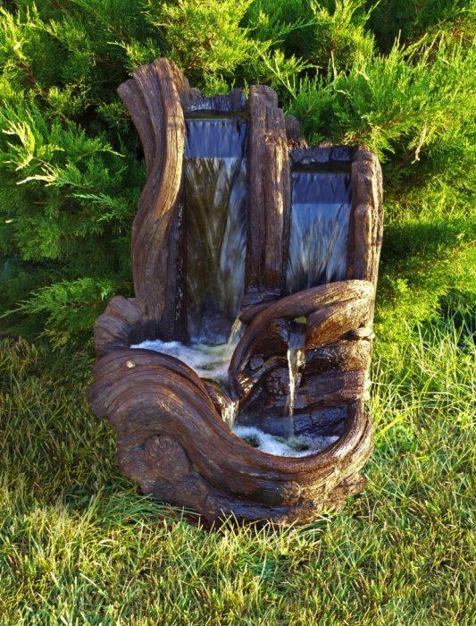 Настоящий Фонтан из дерева станет важным декоративным элементов в вашем саду.