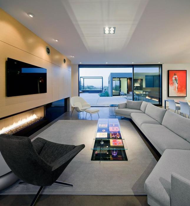 Строго симметричный и гармоничный стиль гостиной комнаты, в которой присутствуют правильные формы и минимализм в интерьере.