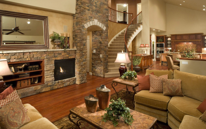 Каменные стены – главная деталь интерьера гостиной комнаты в стиле кантри.