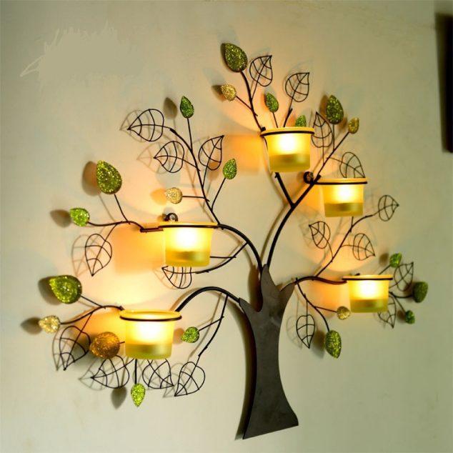 Кованый настенный подсвечник в форме дерева для любителей экостиля.