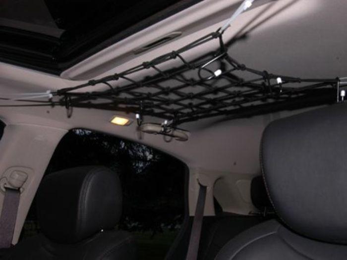 Сетка под крышей багажника. | Фото: popularmechanics.com.