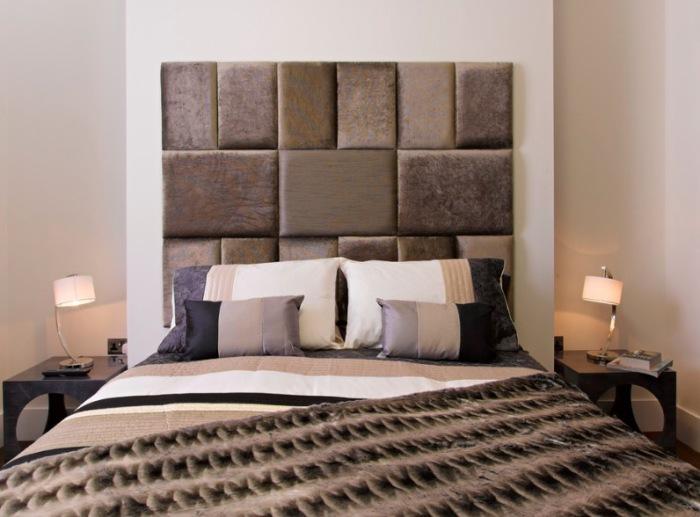 Изголовье кровати из кожи и текстиля станет изюминкой интерьера спальни.