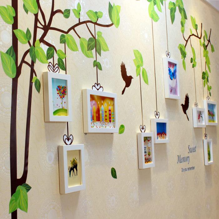 Нарисованное на стене дерево в качестве фона для фото.