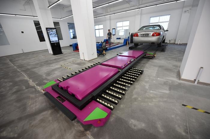 Робот-парковщик, который позволит увеличить автомобильные стоянки наполовину.