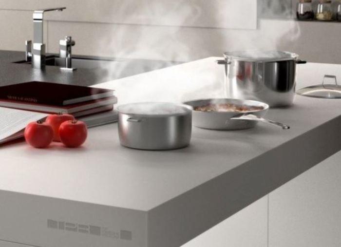 Плита-стол сэкономит место на кухне.
