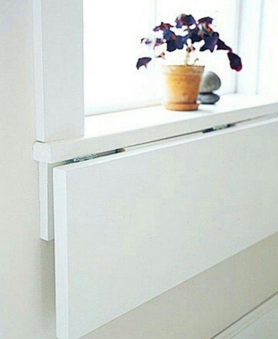 Складной подоконник, как обеденная зона и дополнительная рабочая поверхность.