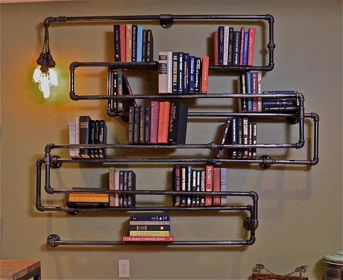 Трубы, которые остались от старого отопления в доме, вы можете использовать как полки для книг.