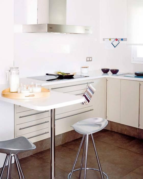 Jдновременно и стол, и дополнительная поверхность для готовки.