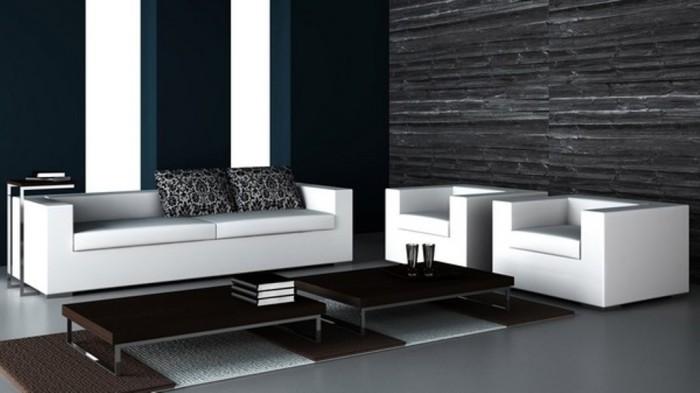 Классика жанра - чёрные обои и белый диван с креслами.