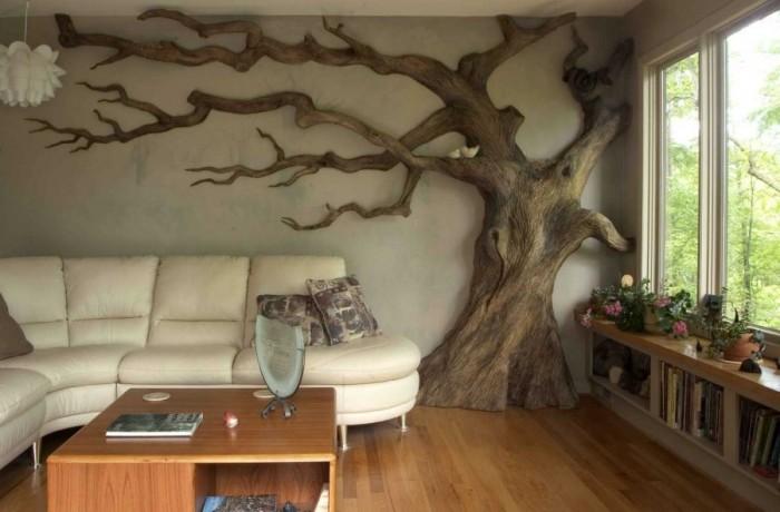 Для украшения стены идеально подойдёт массивная декорация в виде дерева. Такой элемент декора идеально будет смотреться в комнате в стиле минимализм.