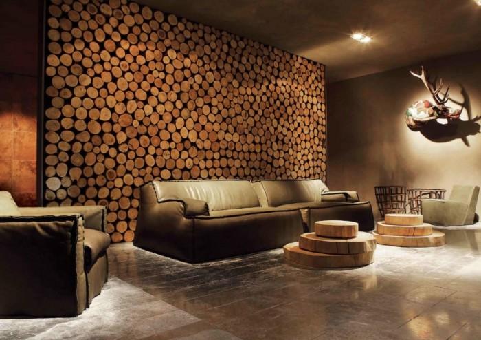 Имитация бревенчатой стены придаст интерьеру особую атмосферу тепла и уюта. Такая идея отлично будет смотреться как в гостиной, так и в зоне отдыха.