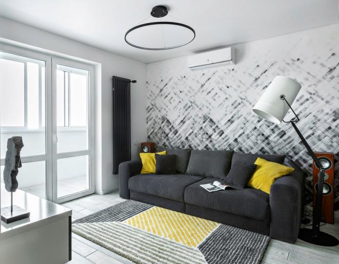 Для создания акцентной стены за диваном используют обои, молдинги, камень, дерево, фотообои и др.